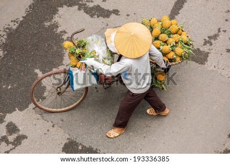Street vendor on a bicycle in Hanoi, Vietnam - stock photo