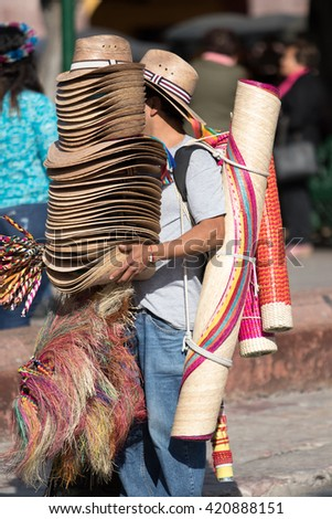 street vendor selling hats in mexico - stock photo