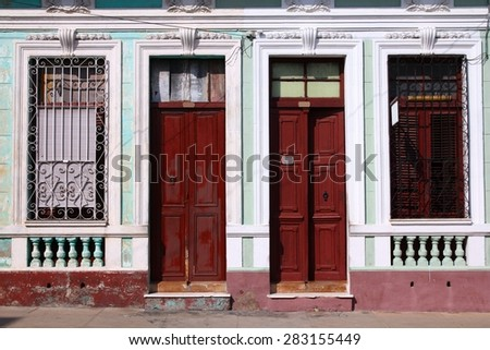 Street view in Cienfuegos, Cuba. The old town is a UNESCO World Heritage Site. - stock photo