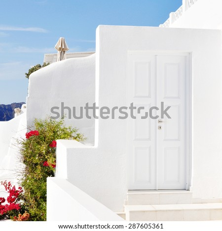 Street view in Oia, small town and former community in the South Aegean on the islands of Thira - stock photo
