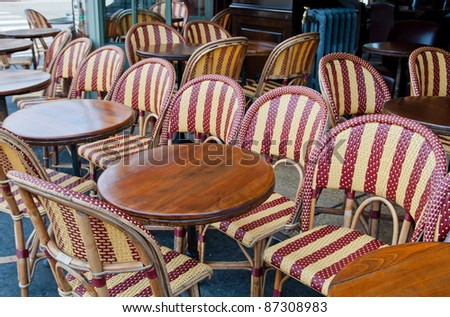 Street view of a Cafe terrace with tables and chairs,paris France - stock photo