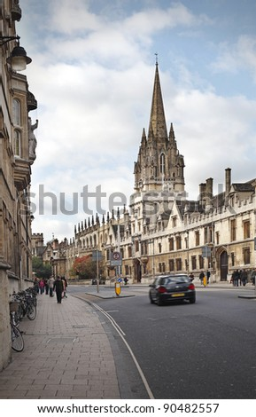 Street view of Oxford city with vintage ancient architectural building against a blue cloudy sky on an autumn day. - stock photo