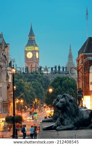 Street view of Trafalgar Square at night in London - stock photo