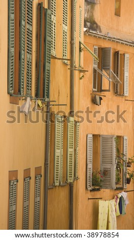 street view of windows in an italian town - stock photo