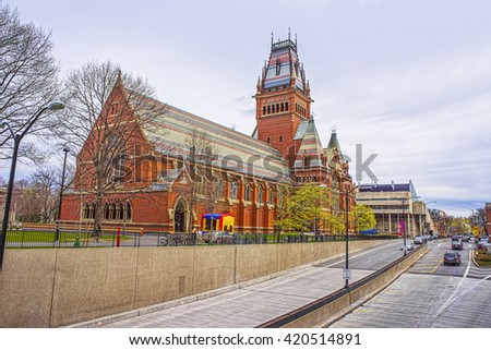 Street view on Memorial Hall and tourists in Harvard University in Cambridge, Massachusetts, USA. It was built in honor of men who died during the American Civil War. - stock photo