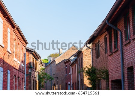 street view with brick houses in Bedburg Alt-Kaster, Germany