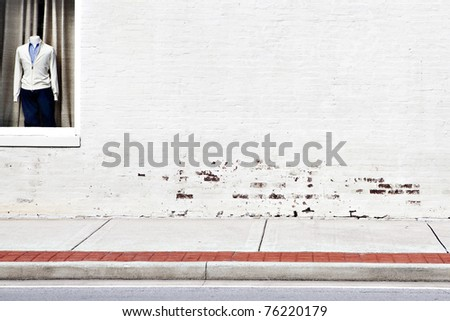 street white brick wall & window shopping - stock photo
