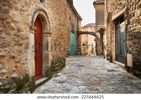 Street with ancient buildings in Grambois village, South France, Provence - stock photo