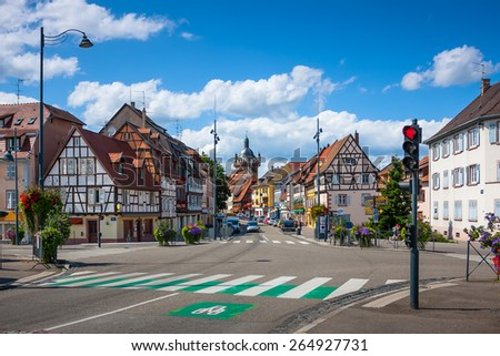 Street with beautiful half-timbered houses in the historic center of Selestat in Alsace. France - stock photo