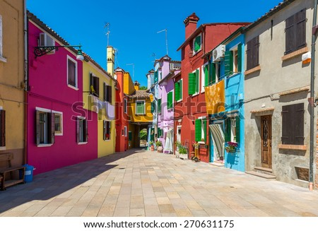 Street with colorful buildings in Burano island, Venice, Italy - stock photo