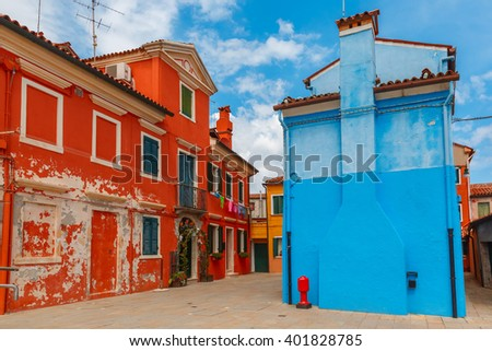 Street with colorful houses on the famous island Burano, Venice, Italy - stock photo