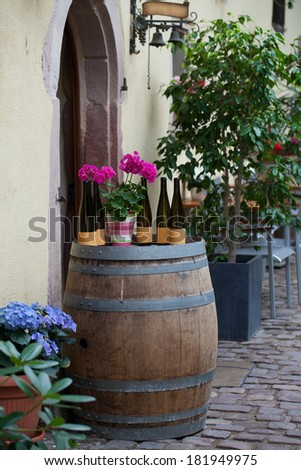 Street with half-timbered medieval houses in Eguisheim village along the famous wine route in Alsace, France - stock photo
