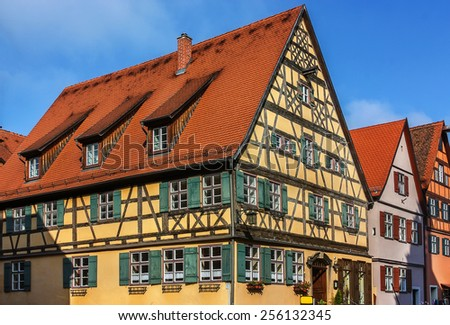Street with historic houses in the Dinkelsbuhl city center. Dinkelsbuhl is old Franconian town, one of the best-preserved medieval urban complexes in Germany.  - stock photo