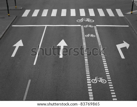 street with lanes, arrows and a cycling path - stock photo