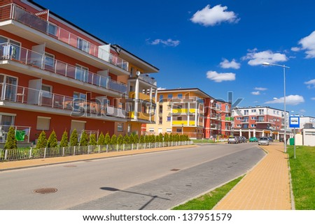Street with new apartments in Poland - stock photo