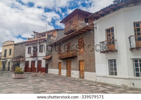 Street with old colonial buildings in the center of Cuenca, Ecuador