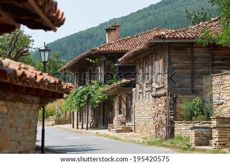 Street with old houses in Zheravna village, Bulgaria - stock photo