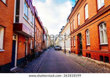 Street with old nice colorful houses in historical center of Malmo, Sweden - stock photo