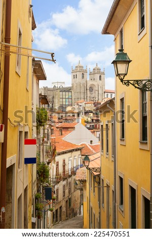 street with stairs in down town, with view of Se cathedral of Porto, Portugal - stock photo