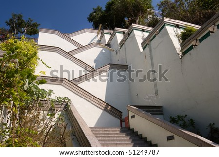 Street with stairs in outdoor with white color under blue sky. Famous landmark in Kaohsiung, Taiwan.