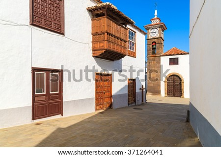 Street with typical Canary style church in San Juan de la Rambla town, Tenerife, Canary Islands, Spain - stock photo