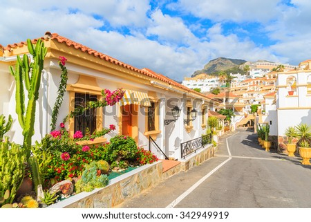 Street with typical Canary style holiday apartments in Costa Adeje, Tenerife, Canary Islands, Spain - stock photo