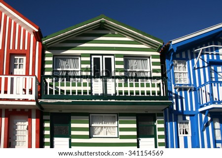street with typical striped houses Costa Nova, Aveiro, Portugal - stock photo