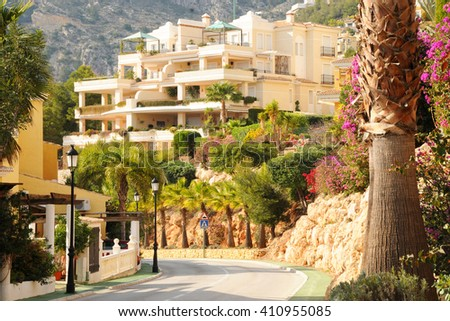 Street with typical  style holiday apartments in Costa Blanca - stock photo