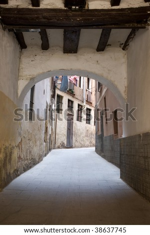 Street with vault in the old town of Barcelona - stock photo