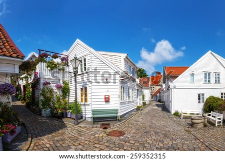 Street with white houses in the old part of Stavanger, Norway. - stock photo