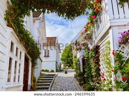 Street with white wooden houses in old centre of Stavanger - Norway - architecture background - stock photo