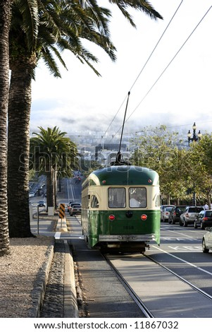 Streetcar in San Francisco with the Twin Peaks in fog in the background - stock photo