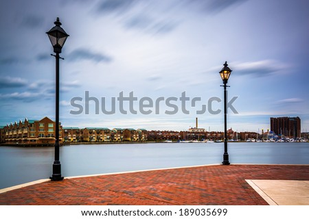 Streetlamps and the Waterfront Promenade in Fells Point, Baltimore, Maryland. - stock photo
