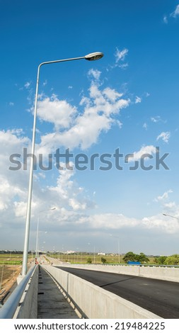 Streetlight isolated on blue sky