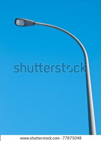 Streetlight isolated on blue sky - stock photo