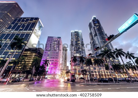 Streets and Buildings of Downtown Miami at night. - stock photo