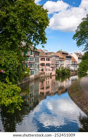 "Streets and water canal in old and beautiful district ""Petite France"" in Strasbourg. Alsace, France - stock photo"