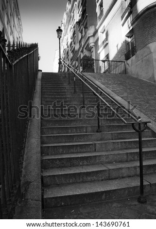 Streets of Paris in black and white. Stairs in Paris - stock photo