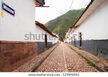 Streets of Pisac in Peru, cobblestone streest in the inca sacred valley - stock photo
