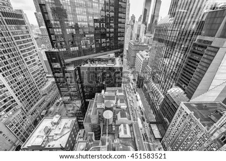 Streetward view of New York City. Manhattan skyline from rooftop.