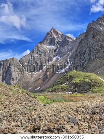 Strelnikov Peak (3284 m) - the highest peak of the Siberian Alps. Sayan mountains. The Republic of Buryatia - stock photo