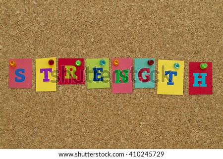 Strength word written on colorful notes pinned on cork board. - stock photo