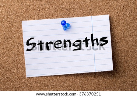 Strengths - teared note paper  pinned on bulletin board - horizontal image - stock photo