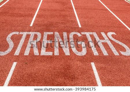 Strengths written on running track - stock photo