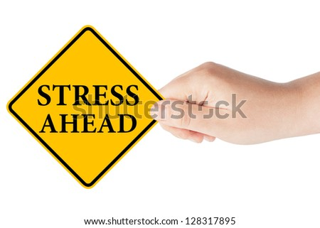 Stress Ahead traffic sign in woman's hand on a white background - stock photo