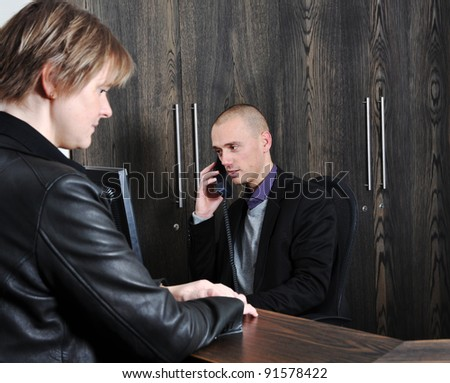 Stress at the hotel reception, any rooms available - stock photo