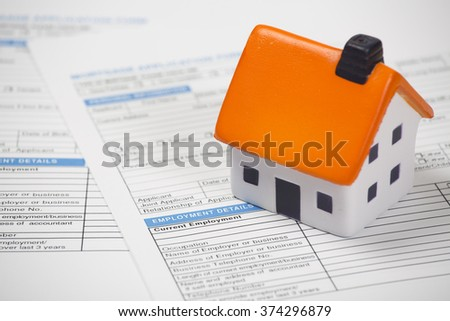 Stress ball house on mortgage documents