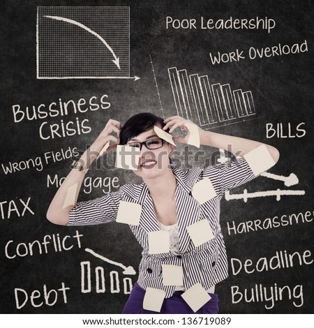 Stress business woman in front of blackboard - stock photo