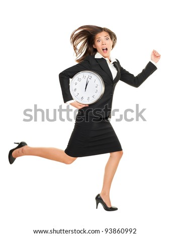 Stress - business woman running late with clock under arm. Concept photo with young businesswoman in hurry running against time. Caucasian / Chinese Asian isolated on white background in full length
