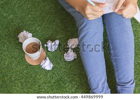 stress businesswoman make a mistake with paper on artificial grass - stock photo